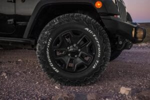 An off-road tire on a car